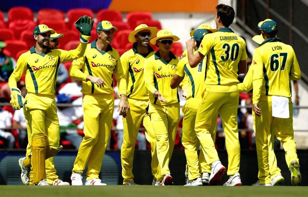 Australia's Pat Cummins celebrates fall of Rohit Sharma's wicket during the second ODI match between India and Australia at Vidarbha Cricket Association (VCA) Stadium, in Nagpur, on March 5, ... - Rohit Sharma