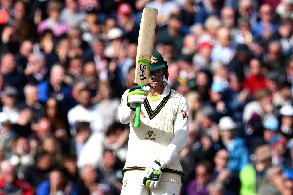 Australia's Tim Paine celebrates his half century on Day 2 of the 4th Test match between Australia and England at Old Trafford, in Manchester on Sep 5, 2019.