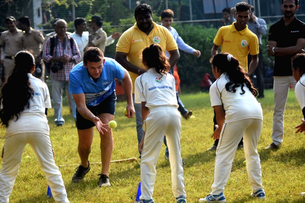 Australian cricket commentator and former captain Adam Gilchrist shares his skills with the students during his visit to Karnataka Sporting Academy in Mumbai on Nov 6, 2019. - Adam Gilchrist