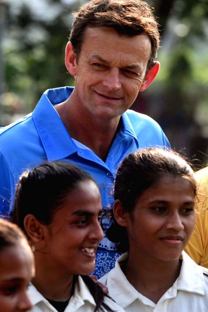 Australian cricket commentator and former captain Adam Gilchrist with students during his visit to Karnataka Sporting Academy in Mumbai on Nov 6, 2019. - Adam Gilchrist