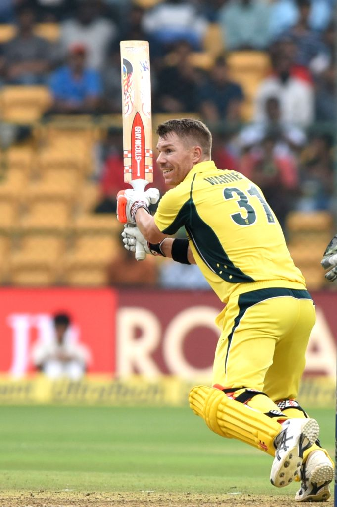 Australian cricketer David Warner in action during the fourth ODI cricket match between India and Australia at M. Chinnaswamy Stadium in Bengaluru on Sept 28, 2017.