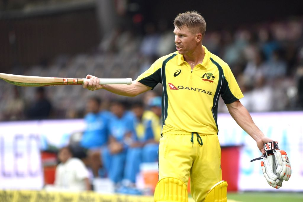 Australian cricketer David Warner walks back to the pavilion after getting dismissed during the fourth ODI cricket match between India and Australia at M. Chinnaswamy Stadium in Bengaluru ...