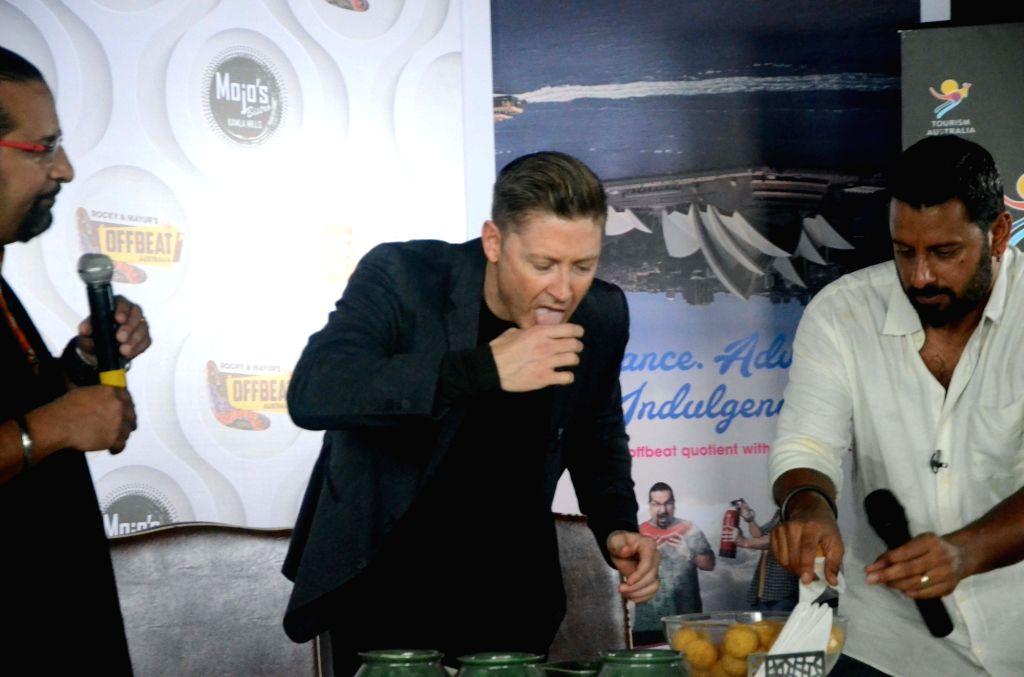 Australian cricketer Michael Clarke having Paani Puri, an Indian snack, during a program in Mumbai on Aug. 18, 2017.