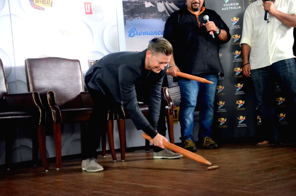 Australian cricketer Michael Clarke playign a game during a program in Mumbai on Aug. 18, 2017.