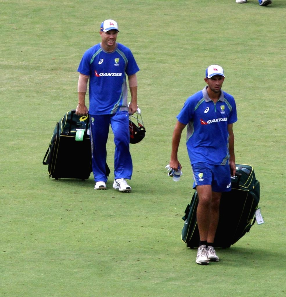 Australian cricketers Ashton Agar and David Warner during a practice session at MA Chidambaram Stadium in Chennai on Sept 11, 2017.
