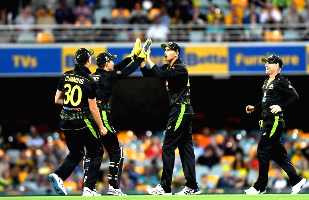 Australian cricketers celebrate fall of a wicket during 2nd T20I match between Sri Lanka and Australia at Brisbane Cricket Ground in Woolloongabba, Brisbane on Oct 30, 2019.
