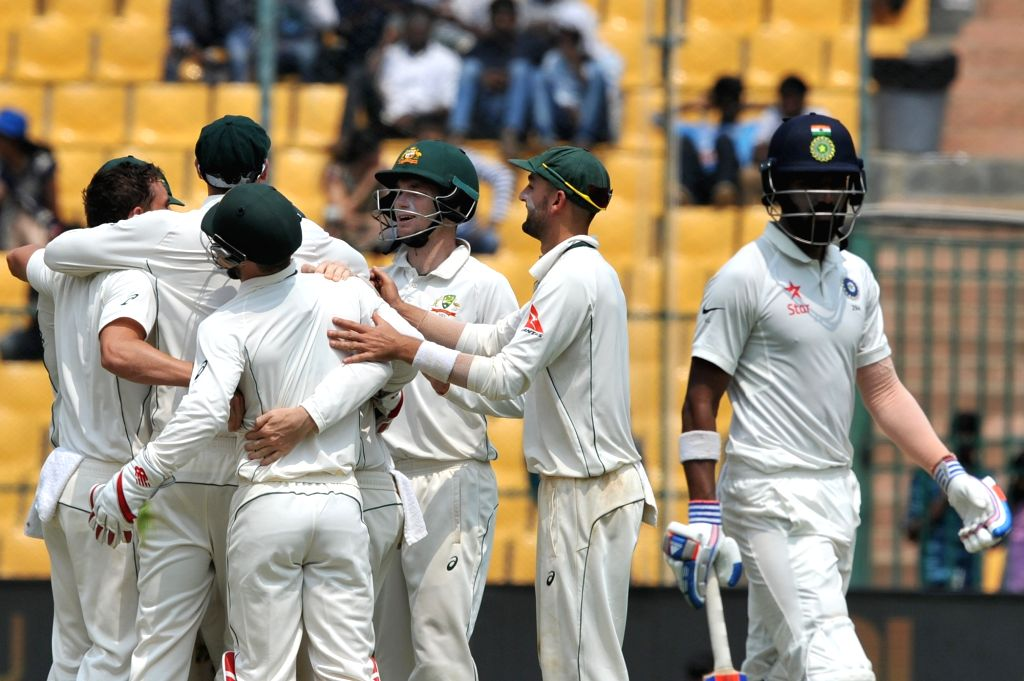 Australian cricketers celebrate fall of Lokesh Rahul's wicket during the third day of the second test match between India and Australia at M. Chinnaswamy Stadium in Bengaluru on March 6, ... - Lokesh Rahul