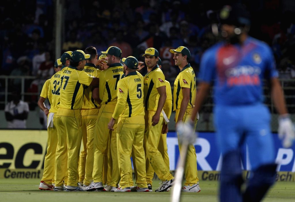 Australian cricketers celebrate fall of Rohit Sharma's wicket during the 1st T20I match between India and Australia at Dr. Y.S. Rajasekhara Reddy ACA-VDCA Cricket Stadium in ... - Rohit Sharma
