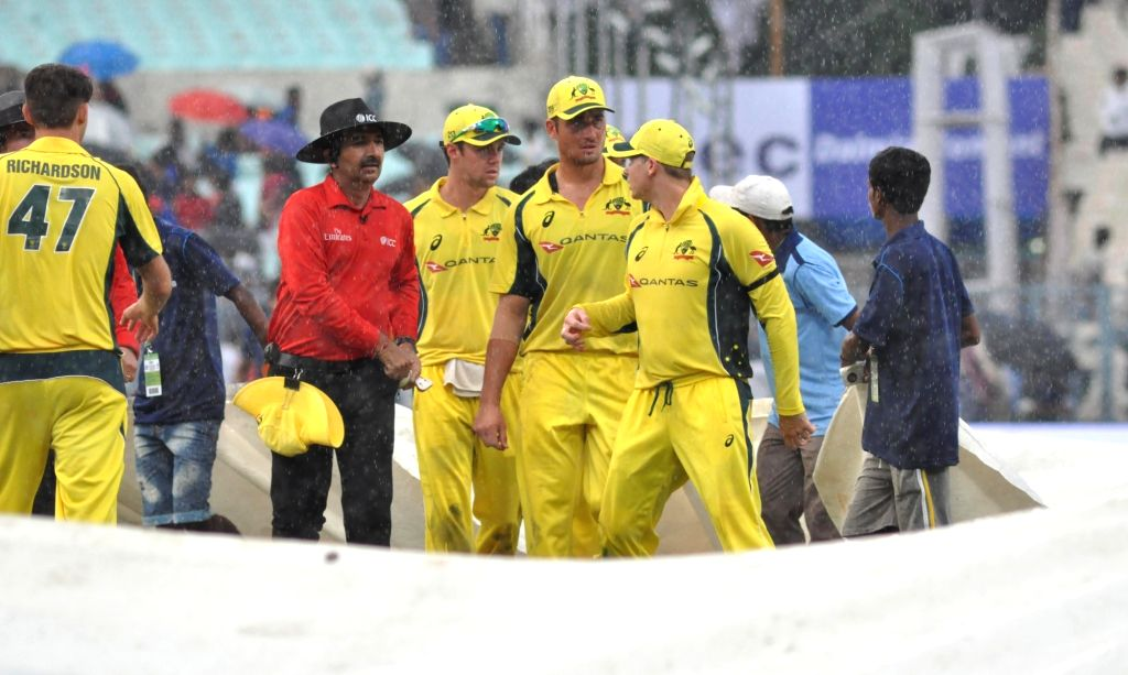 Australian cricketers walks back to the pavilion after rains interrupt the second ODI cricket match between India and Australia at Eden Gardens in Kolkata on Sept 21, 2017.