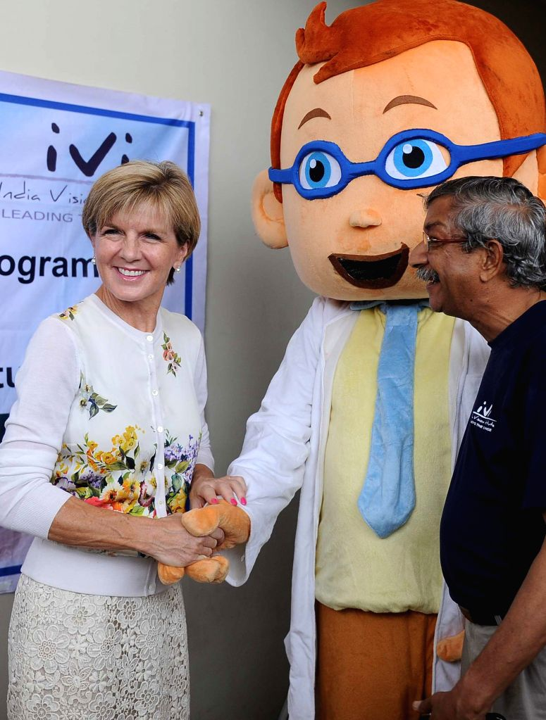 Australian Foreign Minister Julie Bishop interacts with school children at a programme organised to provide free glasses to them as part of an Australian aid program in Chennai on April 15, 2015. - Julie Bishop