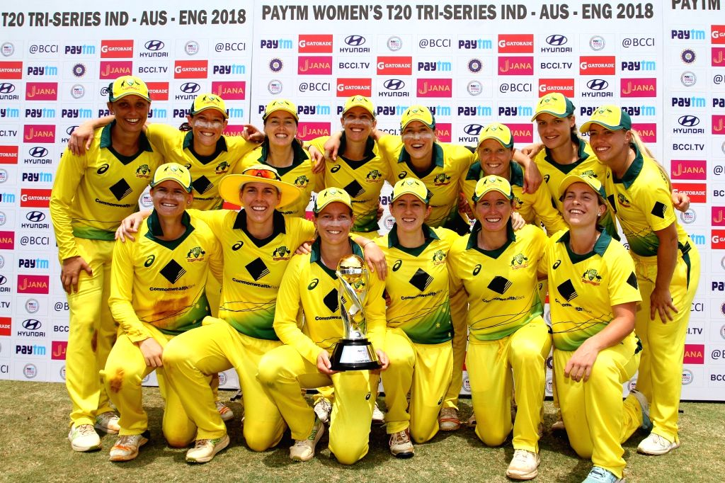 Australian players group picture during post match presentation ceremony after winning the final of the women's tri-series between Australia and England at the Brabourne Stadium in Mumbai on ...