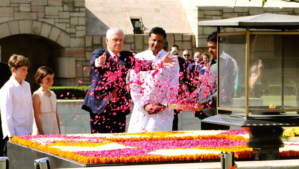 Australian Prime Minister  Malcolm Turnbull pays floral tributes at the Samadhi of Mahatma Gandhi, at Rajghat, in Delhi on April 10, 2017. - Malcolm Turnbull