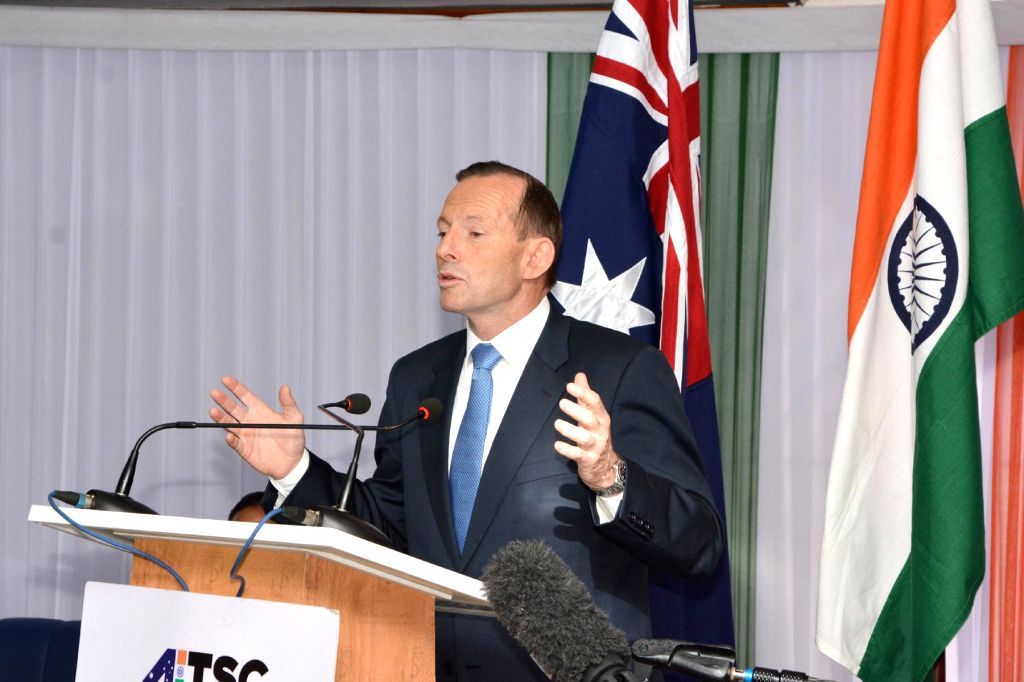 Australian Prime Minister Tony Abbott addresses during a programme organised on his visit to AIIMS Trauma Centre in New Delhi on Sept 5, 2014. - Tony Abbott