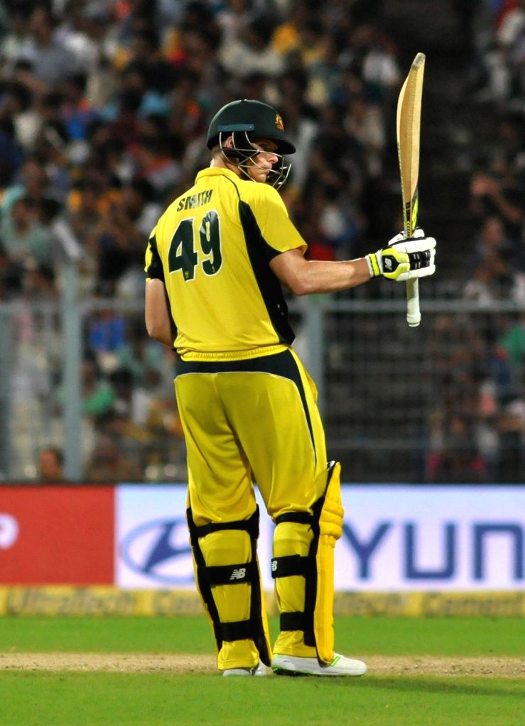 Australian skipper Steve Smith celebrates his half century during the second ODI cricket match between India and Australia at Eden Gardens in Kolkata on Sept 21, 2017.