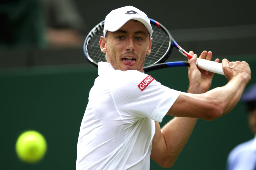Australian tennis player John Millman in action against Spain's Rafael Nadal during men's singles first round of Wimbledon 2017 in London, England on July 3, 2017. Nadal won.