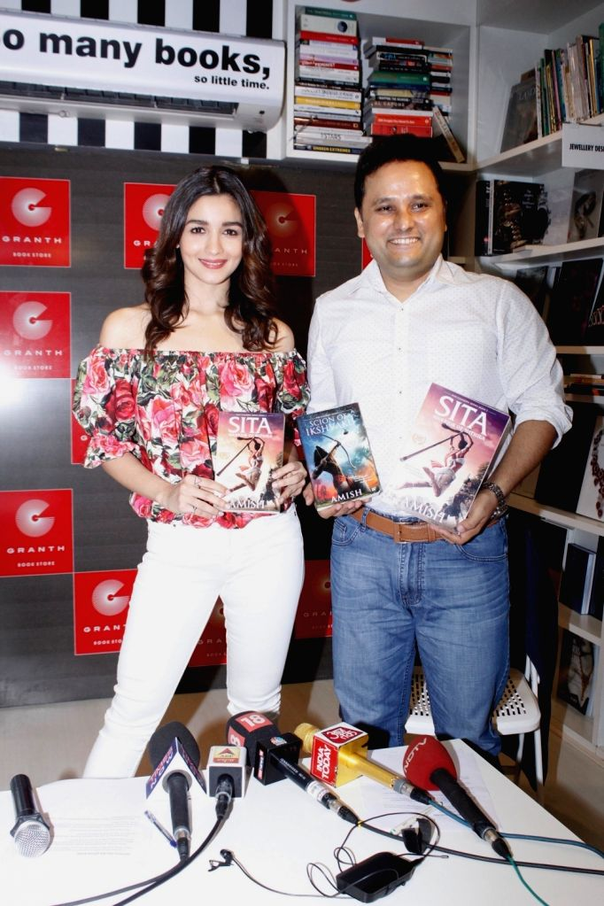 Author Amish Tripathi with actress Alia Bhatt during the trailer launch of Amish Tripathi`s book Sita - Warrior Of Mithila, in Mumbai on May 16, 2017. - Alia Bhatt and Amish Tripathi