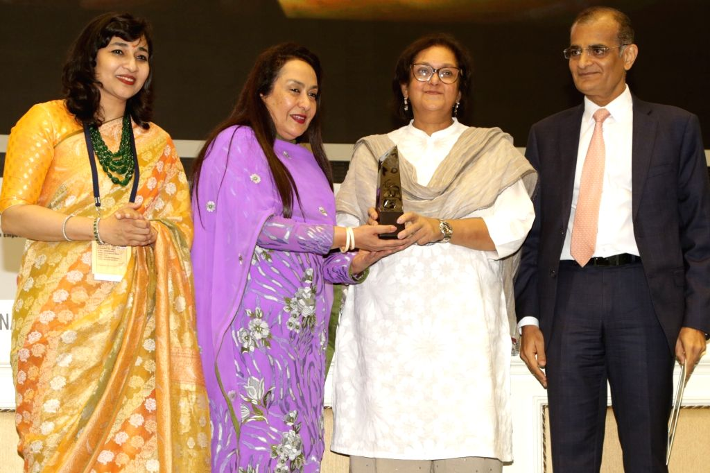 Author and Director of Jaipur Literature Festival Namita Gokhale receives the FLO Icon Award during 34th Annual Session of FICCI Ladies Organisation (FLO) at Vigyan Bhavan in New Delhi on ...
