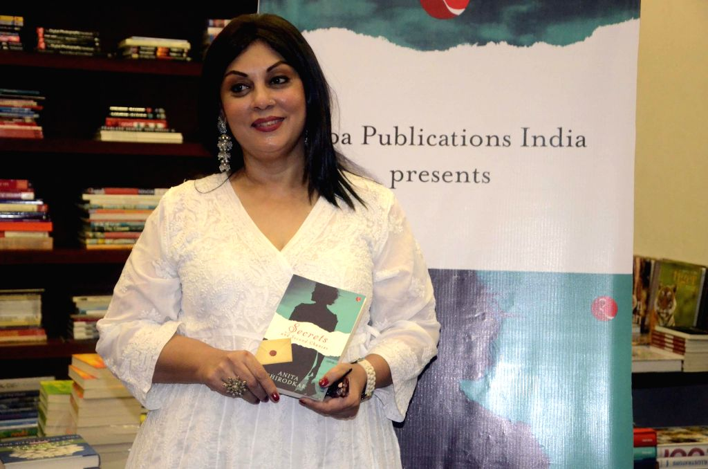 Author Anita Shirodkar during a reading program of her book `Secrets and Second Chances` at Kitab Khana in Mumbai on July 3, 2014.