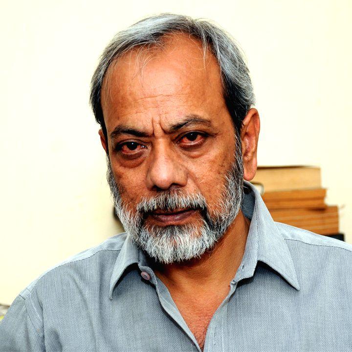 Author, Dhirendra K. Jha