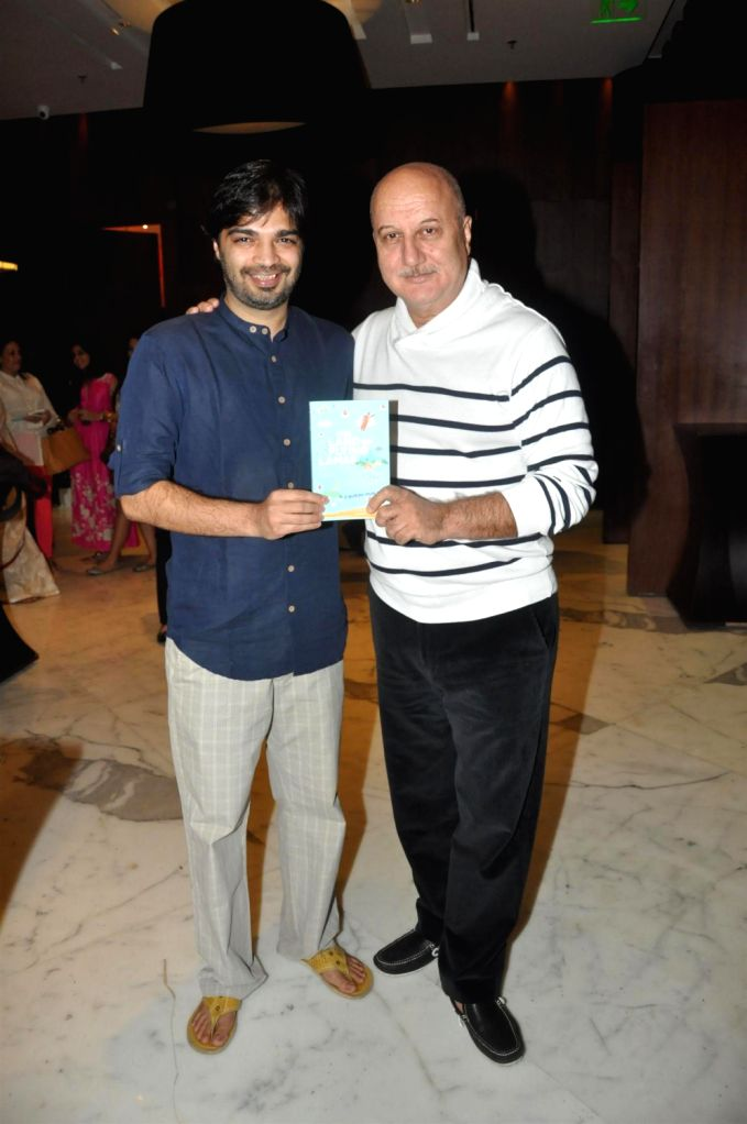 Author Gaurav Punj and actor Anupam Kher during the release of book 'The Land Of The Flying Lamas' written by Gaurav Punj at JW Marriott in Mumbai on December 20, 2013. - Anupam Kher