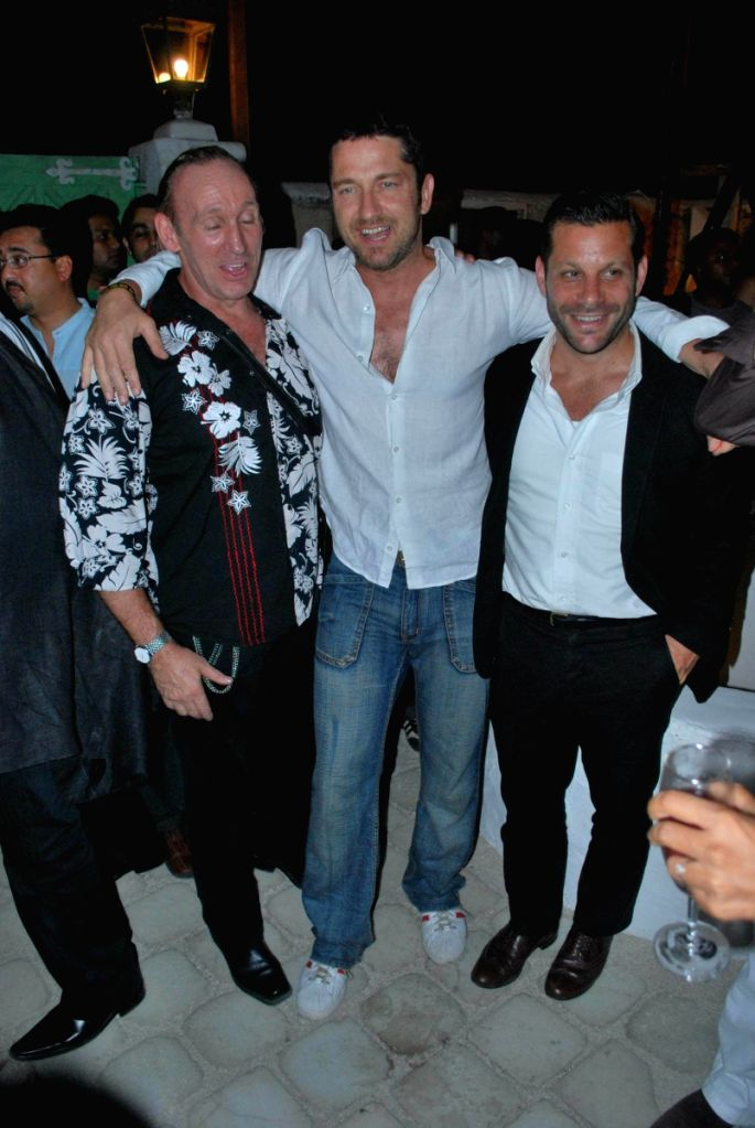 Author Gregory David Roberts with hollywood actor Gerard Butler at GQ magazine bash at Olive.