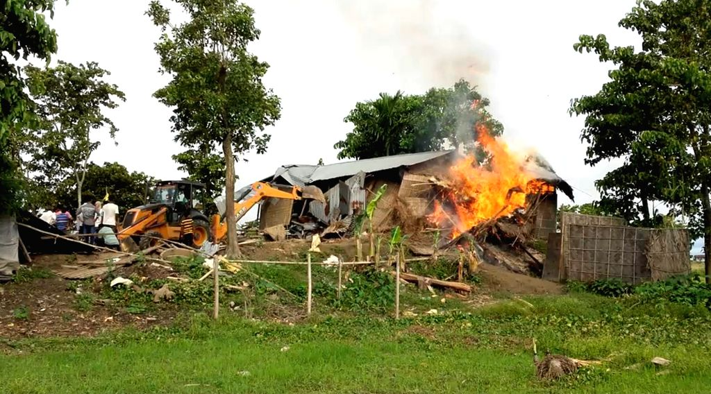 Authorities carry out eviction drive in Banderdubi village under Kaliabor subdivision near  Kaziranga National Park in Assam on Sept 19, 2016. At least two people were killed and several ...
