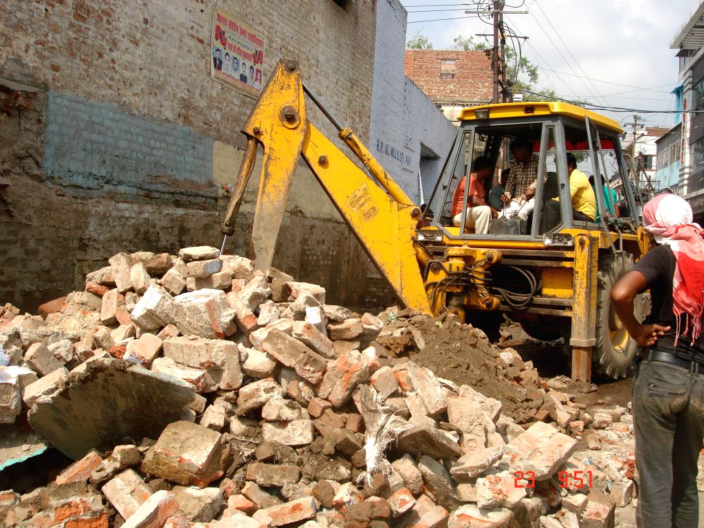 Authorities demolish illegal structures in Agra on July 23, 2015.