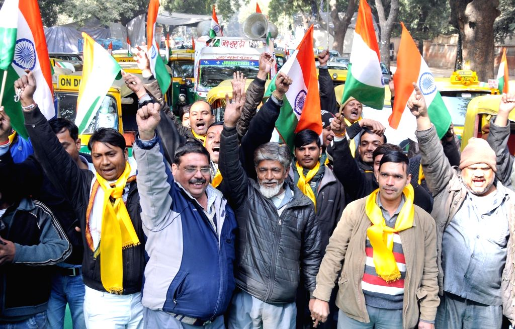 Auto drivers stage a demonstration at Jantar Mantar to press for ban on liquor in New Delhi, on Jan 21, 2016.