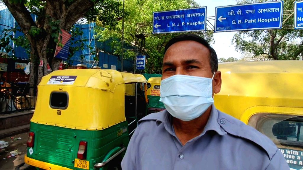 Auto drivers standing outside Kovid Hospital, helping to leave the patient to their destination.