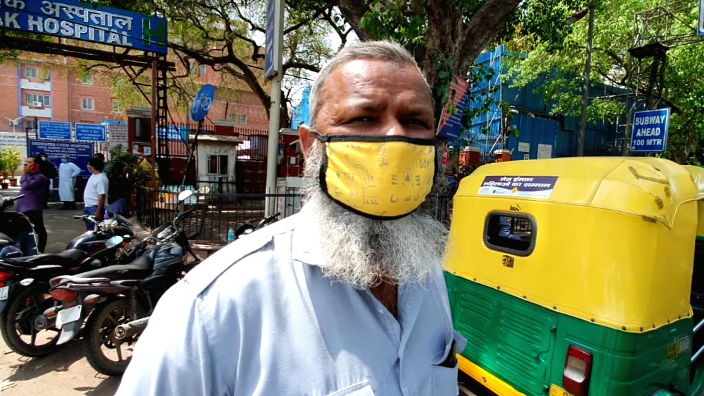 Auto drivers standing outside Kovid Hospital, helping to leave the patient to their destination