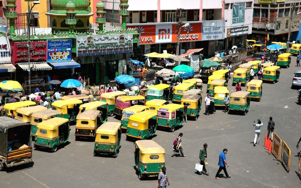 Auto-rickshaws seen parked outside Bengaluru's KR Market due to the lack of passengers as COVID-19 scare grips the city, on March 18, 2020.