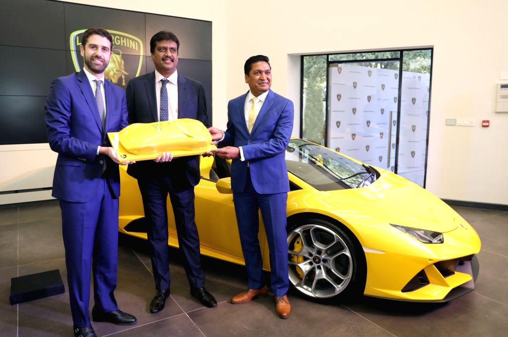 Automobili Lamborghini CEO (Asia Pacific) Matteo Ortenzi and Lamborghini India Head Sharad Agarwal unveil the new Lamborghini Huracan EVO Spyder during the inauguration of its renovated ...