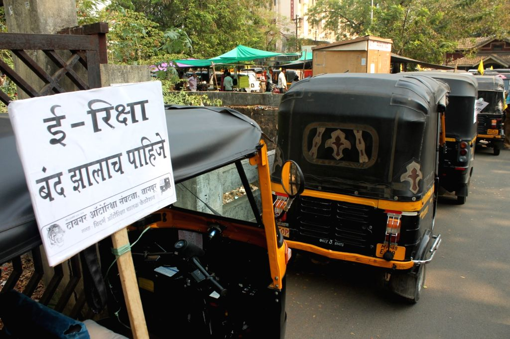 Autorickshaw drivers stage a demonstration against E-rickshaws in Nagpur, on April 20, 2016.