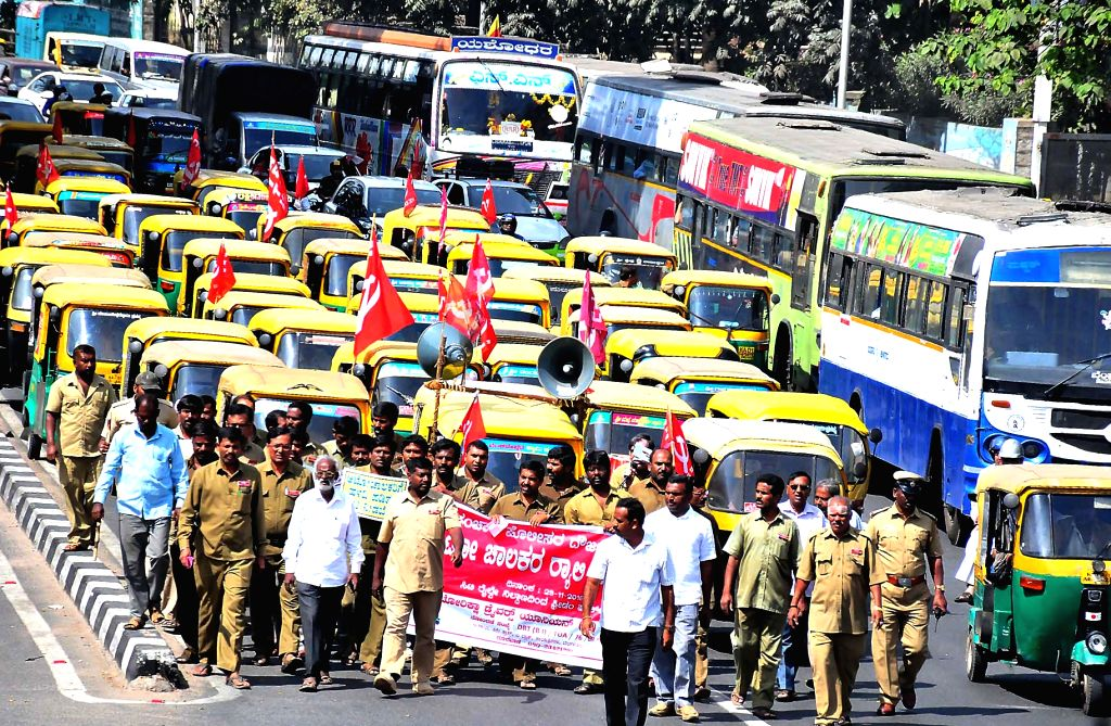 Autorickshaw Drivers Union members take part in protest rally from City Railway Station to Freedom Park to protest against traffic police atrocity on auto drivers in Bengaluru on Nov 29, ...