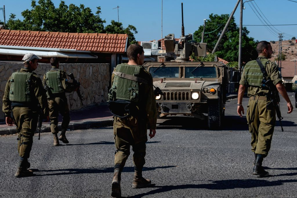 AVIVIM, Aug. 27, 2019 - Israeli soldiers patrol near the northern Israeli town of Avivim, close to the border with Lebanon, Aug. 27, 2019. Lebanese President Michel Aoun warned on Monday that Israeli ...