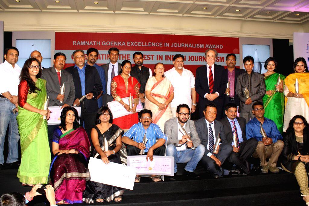 Awardees of `Ramnath Goenka Excellence in Journalism Awards 2011` with Lok Sabha Speaker Sumitra Mahajan in New Delhi on Sept 9, 2014. - Sumitra Mahajan