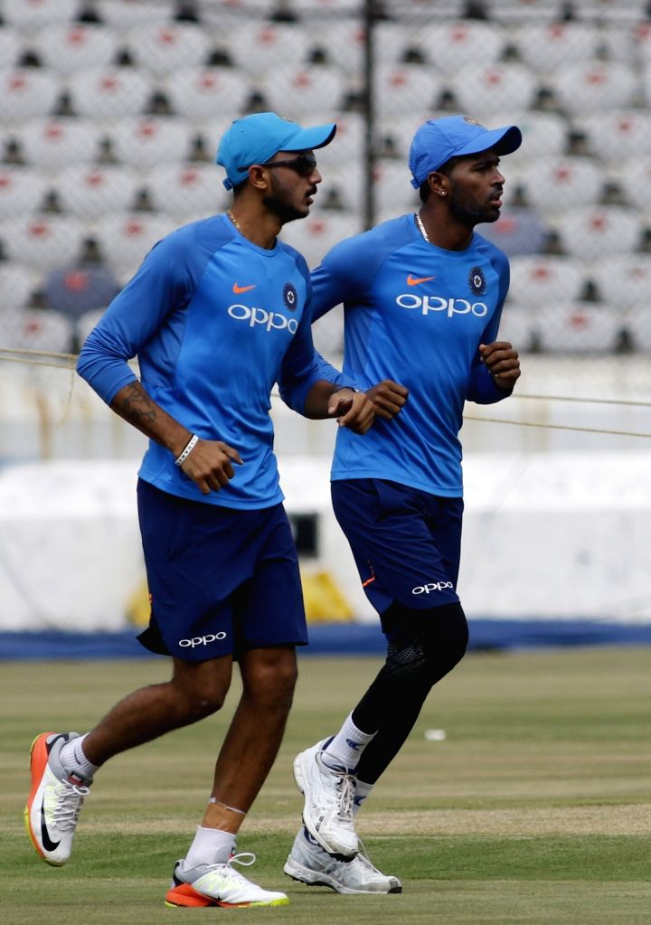 Axar Patel and Hardik Pandya during a practice session ahead of the 3rd T20 match against Australia at the Rajiv Gandhi International Cricket Stadium in Hyderabad on Oct 12, 2017. - Axar Patel