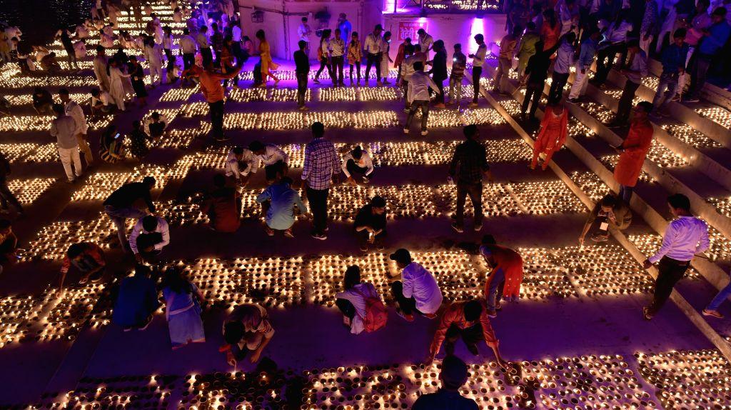 Ayodhya: People light oil lamps during 'Deepotsav' in Ayodhya on Oct 26, 2019. (Photo: IANS)