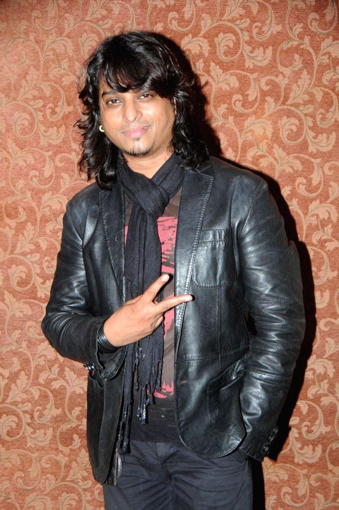 Aziz Zee during the music release of album Kiran, in Mumbai, on Aug 18, 2014.