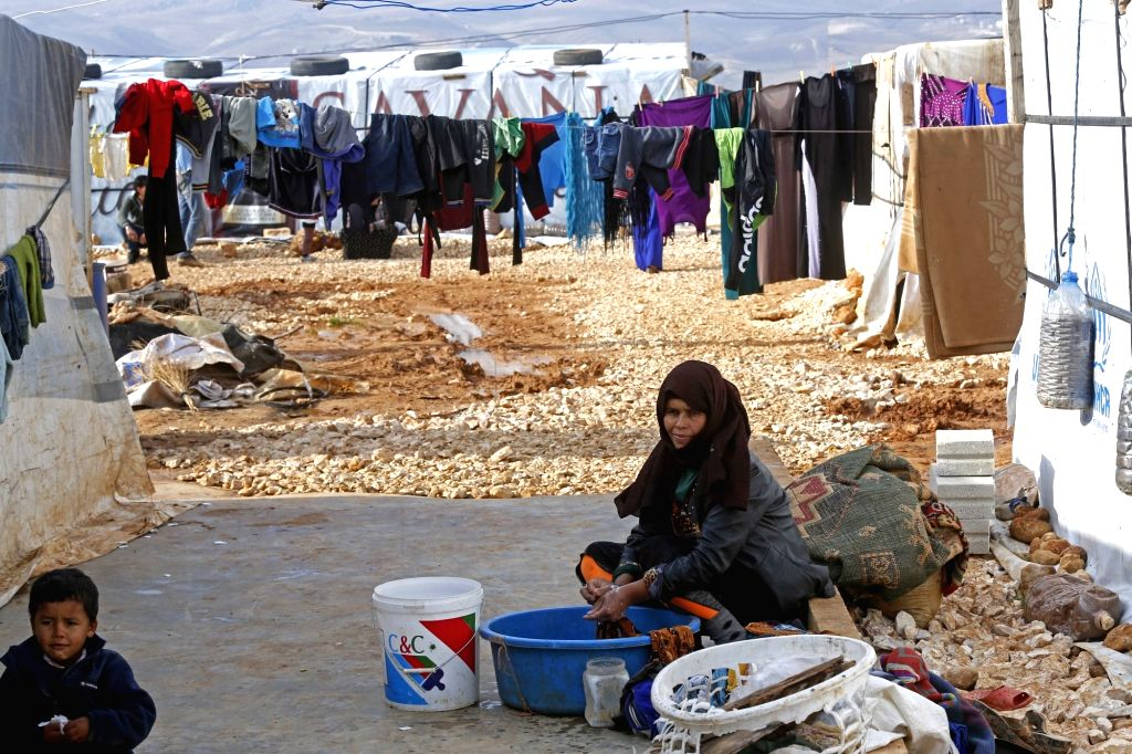 BAALBEK (LEBANON), Dec. 10, 2018 A Syrian woman washes clothes at a refugee camp near the Baalbek City in Lebanon's eastern Bekaa valley, Dec. 10, 2018. The Syrian refugees in the camp ...
