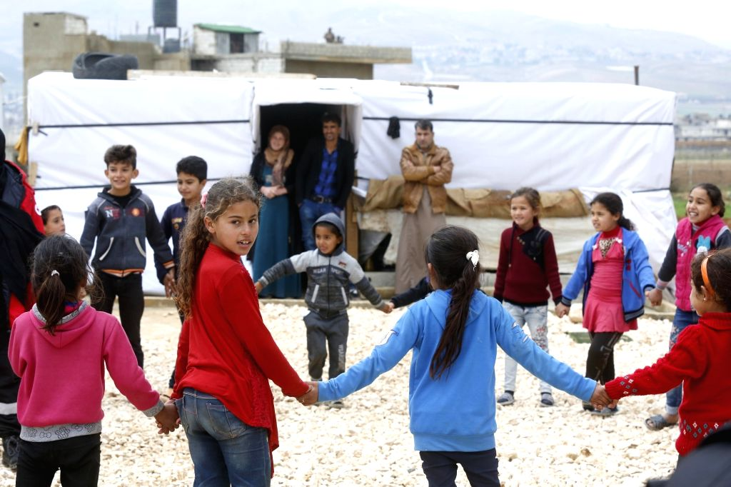 BAALBEK (LEBANON), Dec. 10, 2018 Syrian children play at a refugee camp near the Baalbek City in Lebanon's eastern Bekaa valley, Dec. 10, 2018. The Syrian refugees in the camp will endure ...