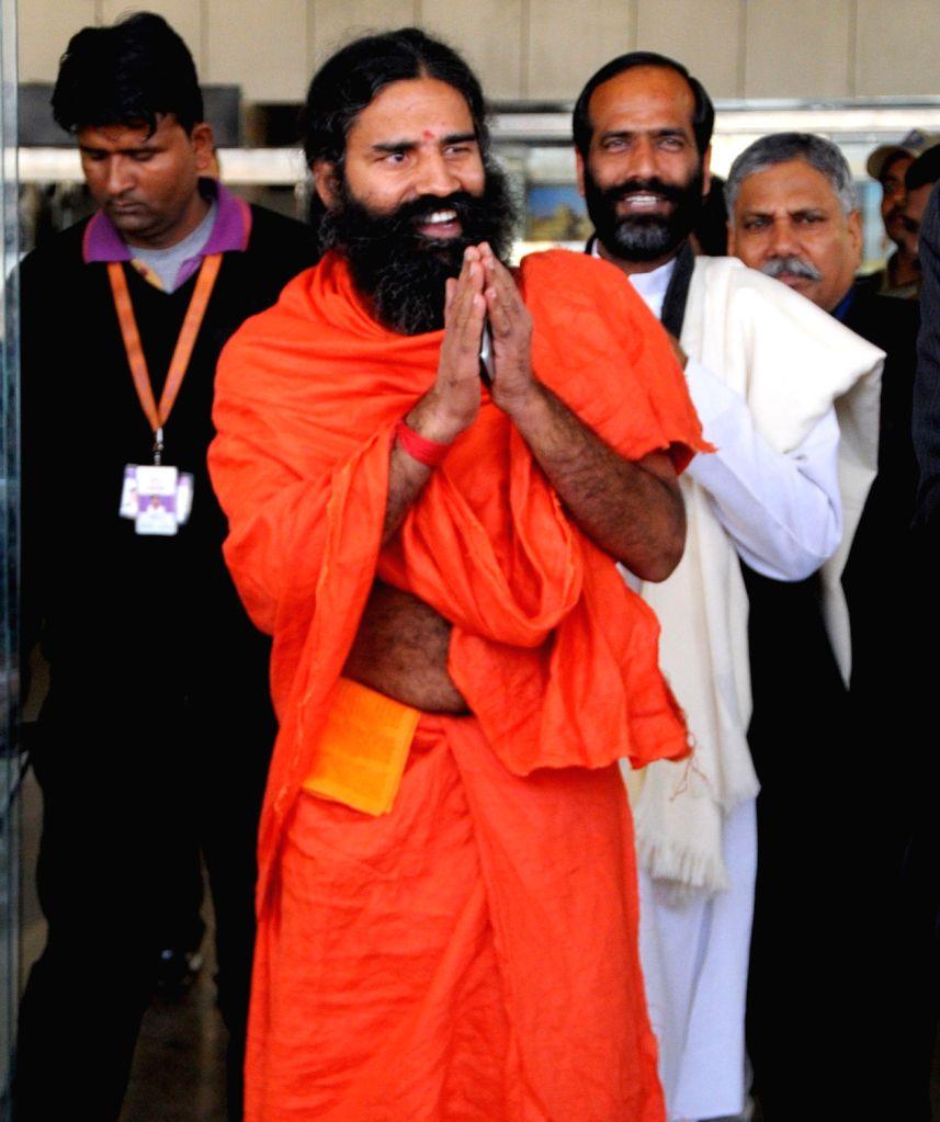 Baba Randav arrives at Jaipur airport on 7 Dec. 2013.