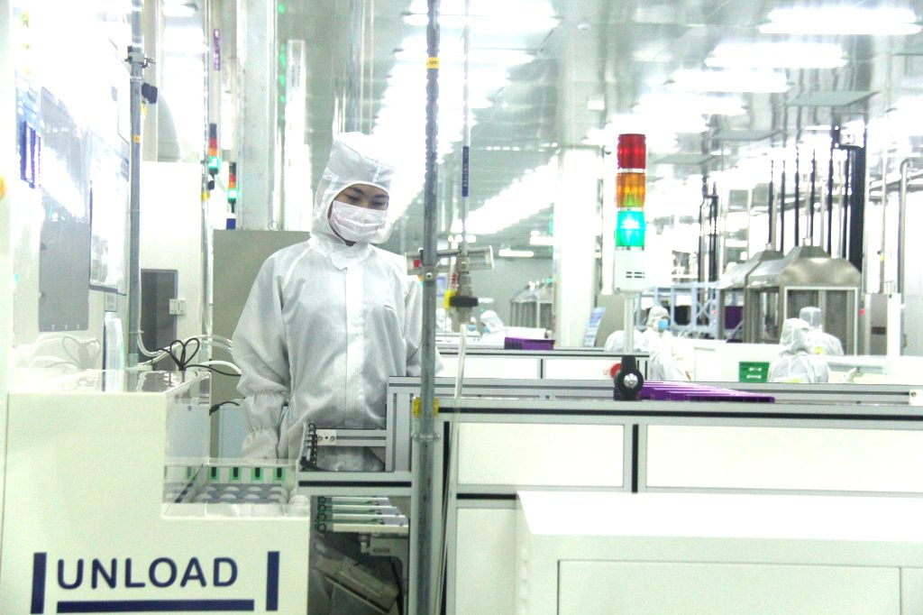 BAC GIANG, Jan. 7, 2017 - Photo taken on Jan. 6, 2017 shows the workshop in solar cell plant of Trina Solar in Bac Giang Province of Vietnam. The largest photovoltaic (PV) cell and module factory in ...