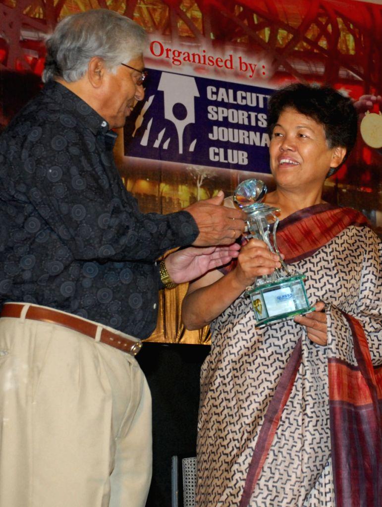 Bachandri Pal  was given Life Time Achievement by Calcutta Sports Journalist Club in Kolkata on 28th Mar 09. With Other Indian International Football player Chuni Goshami.
