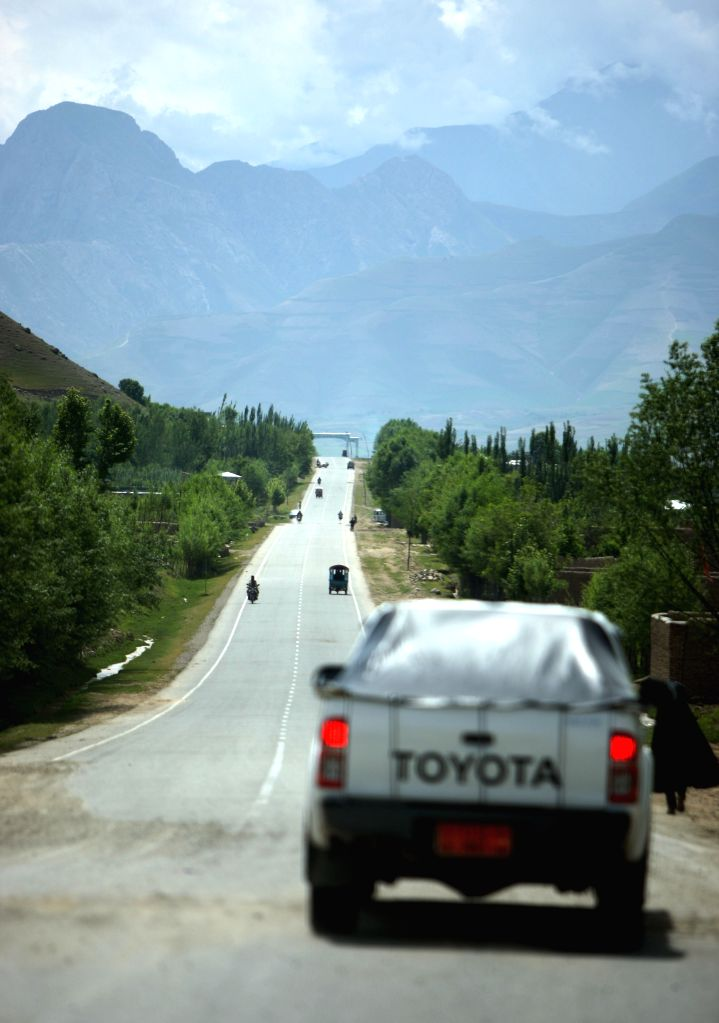 A vehicle travels on a high way in Badkhshan province in northern Afghanistan, May 6, 2014. More than 10,000 kilometers of highway and main roads have been ...