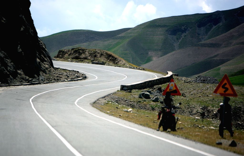 This photo taken on May 6, 2014, shows a high way in Badkhshan province in northern Afghanistan. More than 10,000 kilometers of highway and main roads have been ..