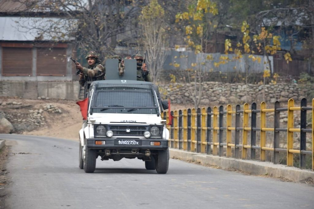 :Badgam: Security personnel during a gunfight with militants in Jammu and Kashmir's Badgam district on Nov 1, 2018. (Photo: IANS).