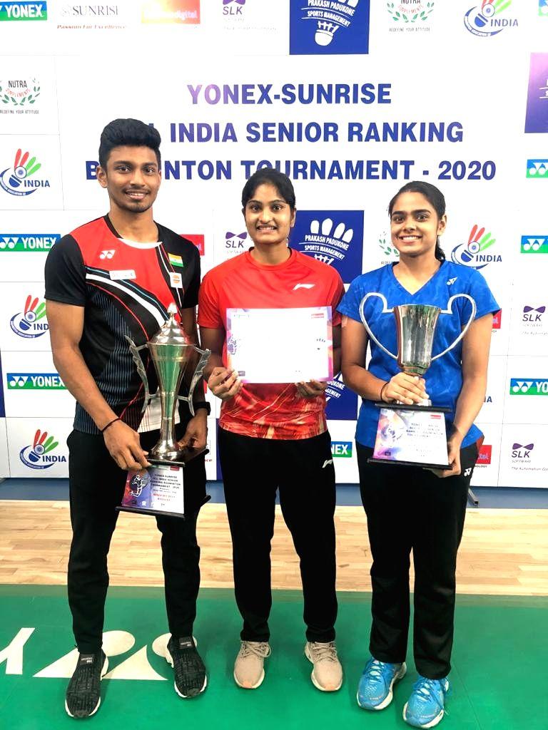 Badminton player Maneesha K poses with her mixed doubles partner MR Arjun and women's doubles partner Rutaparna Panda at the Yonex Sunrise All India Senior Ranking Tournament in Bengaluru ...