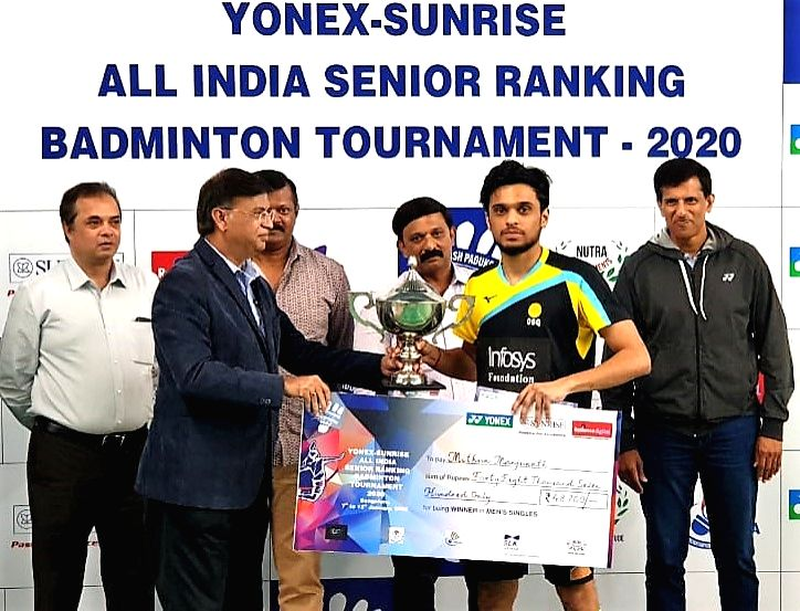 Badminton player Mithun Manjunath poses with his Men's singles trophy at the Yonex Sunrise All India Senior Ranking Tournament in Bengaluru on Jan 12, 2020.