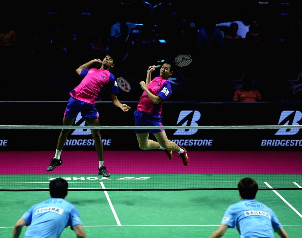 Badminton players Chirag Shetty and Hendra Setiwan in action during the Premier Badminton League at the GMC Balayogi SATS Indoor Stadium in Hyderabad on Feb 3, 2020. - Chirag Shetty
